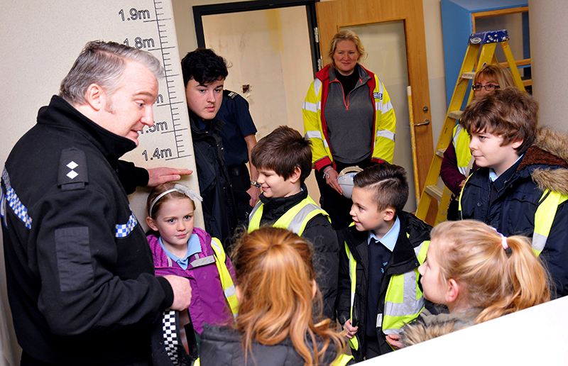 Chalk Ridge Primary School children and local Cadets visit the Police Inspection Centre to help bury a time capsule ahead of the opening in a few months time. Insp Tony Maggs show the visitors around. Viables, Basingstoke.