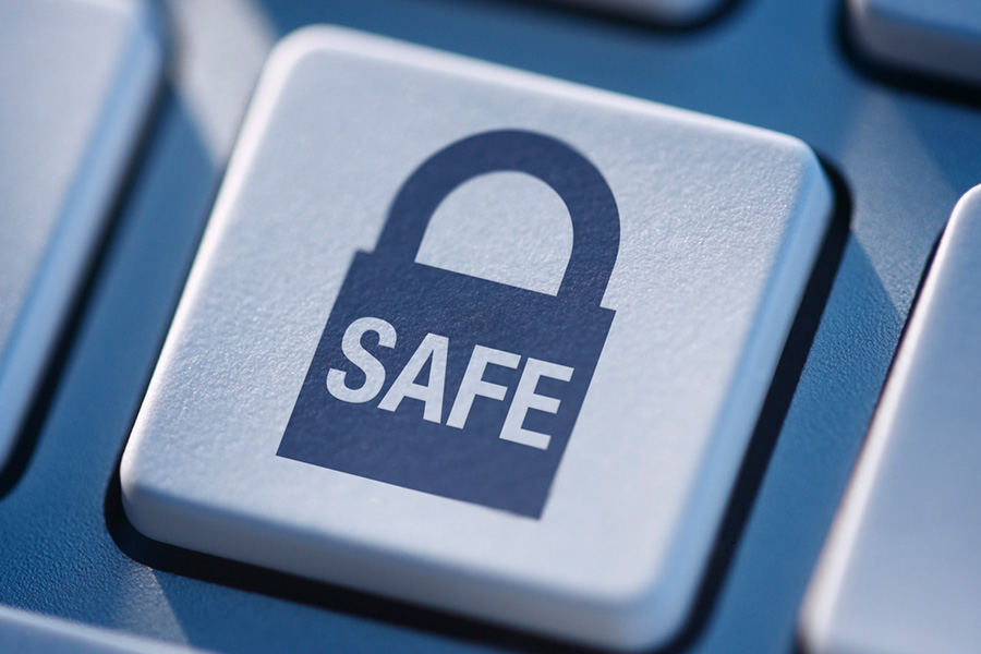 Internet safety: keyboard button with a padlock and safe written on it
