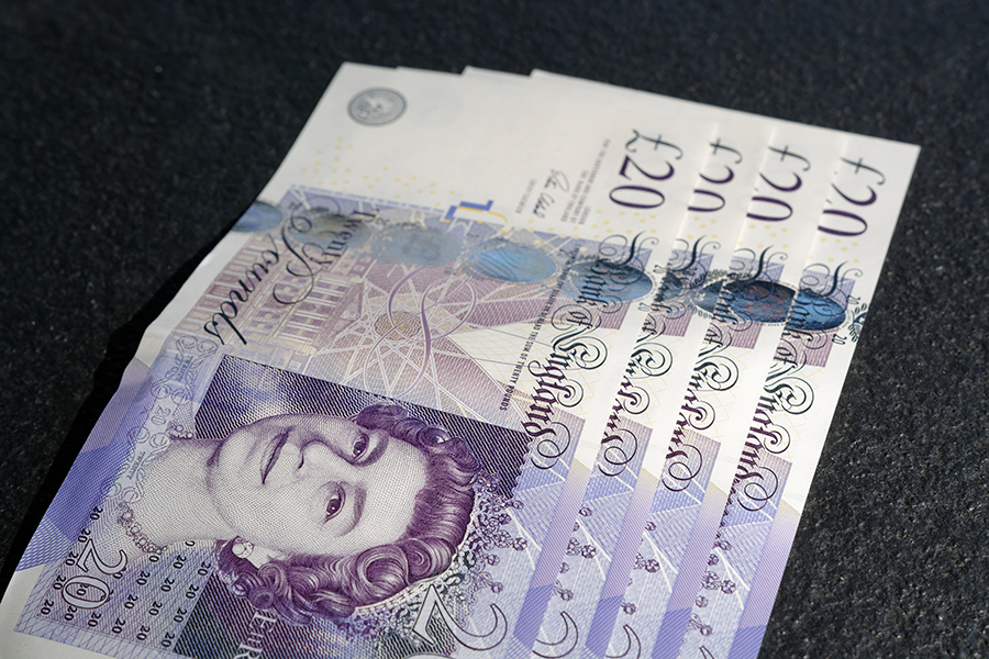 Four £20 notes lined up